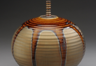 「jar with gold and brown glaze」